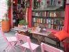 A bookshop with chairs and a table outside