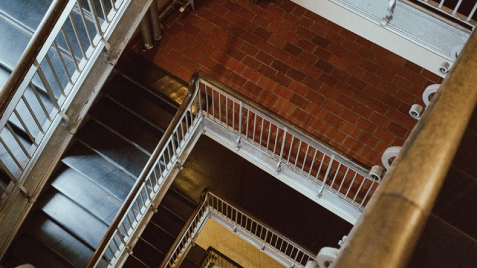A photograph of a staircase spiraling downward