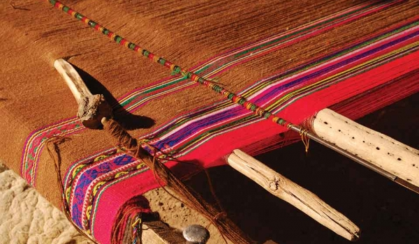 A photograph of a Native weave on a wooden loom