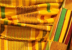The traditional Ghanian kente cloth that Meshack Asare wore to the 2015 Neustadt Festival ceremony.