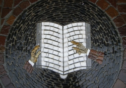Table with mosaic design of a book