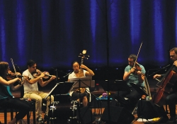 Liu Fang (center) plays the pipa during a rehearsal with the Matangi Quartet.