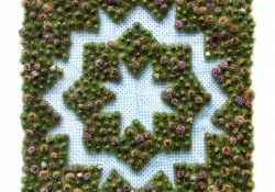 An image that looks like needlepoint utilizing burdock plants