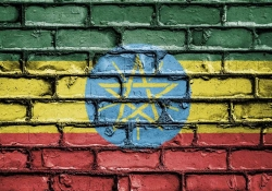 The flag of Ethiopia spray painted on a brick wall