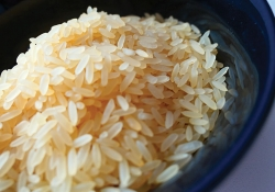 A bowl of rice, lightly colored by an application of soy sauce