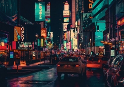 A dense urban scene with brightly colored signs lighting the night