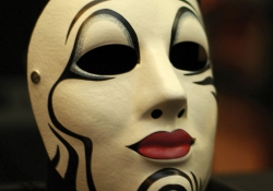 An ornately painted harlequin mask