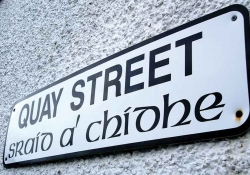 A photograph of a sign that reads (in English) Quay Street with the Gaelic translation printed below