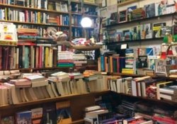 A photograph of the cluttered interior of a bookstore