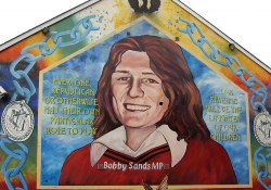 """A mural with a painting of Bobby Sands. The text reads """"Everyone. Republican or otherwise has their own particular role to play...our revenge will be the laughter of our children."""""""