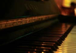 A close-up photograph looking down the keys on a piano