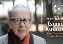 A photograph of writer Ismail Kadare who is identified by text as the 2020 Neustadt Laureate