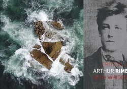 A rock being whipped by ocean waves from above with the cover to the Rimbaud biography inset on the right side of the image