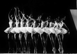 A time-elapsed black and white photograph of a dancer