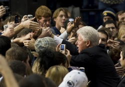 Bill Clinton shaking hands with students