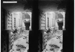 A double exposure of a bombed out alley as seen through a doorway