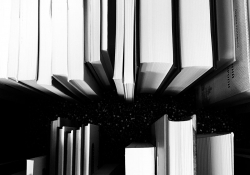 Overhead view of books in black and white