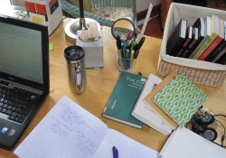 An organized desk with books and papers on it