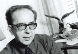 A black and white photograph of Ismail Kadare