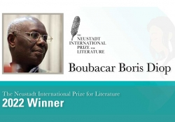 A photograph of Boubacar Boris Diop accompanied by text announcing him as the 2022 Neustadt Laureate