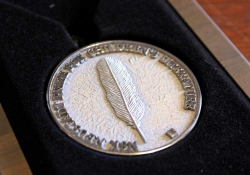 A close-up photo of the NSK medal