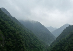 """Christopher, Tania, and Isabelle Luna, """"Mountains and Rain"""" (the hills of Fuzhou), September 2009"""