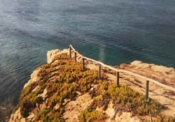 A rough dirt road terminates at the end of a point that sits on a cliff above a wine-dark sea