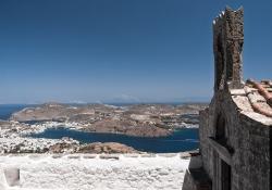 A stone structure overlooks the Aegean Sea off the coast of Patmos