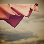 Salmon colored cloth on a clothesline