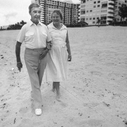 Dick Francis and wife, Mary, stroll along the beach in Fort Lauderdale, Florida.