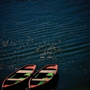 Two boats on dark blue water with ripples